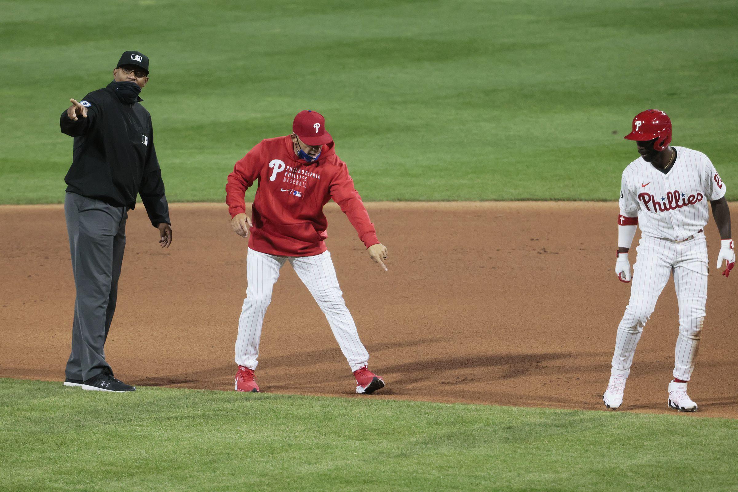 MLB umpires call Andrew McCutchen out on play and anger Joe Girardi.