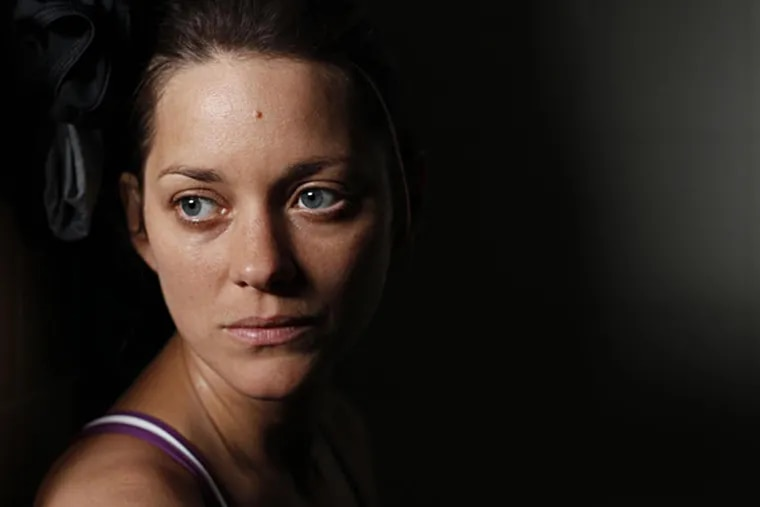 """Marion Cotillard, Oscar-winner for """"La Vie en Rose,"""" plays a double amputee involved with a drifter in """"Rust and Bone,"""" which opens Friday. Rex Features"""