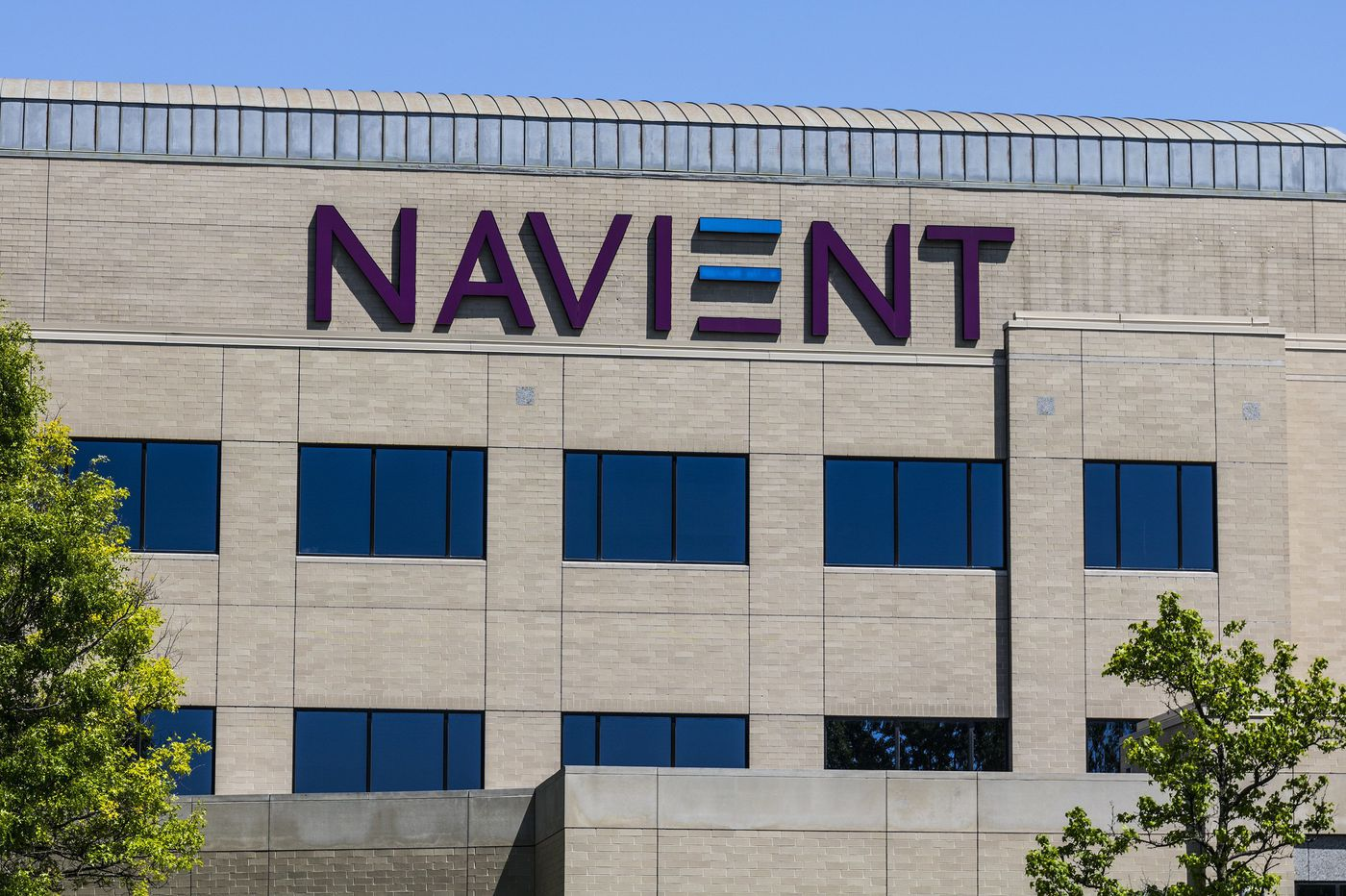 Student loan activists call on Navient to suspend share buybacks, dividend