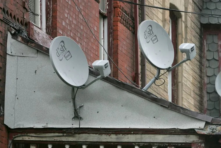 Satellite dishes in North Philadelphia. Can you be poor and have one?