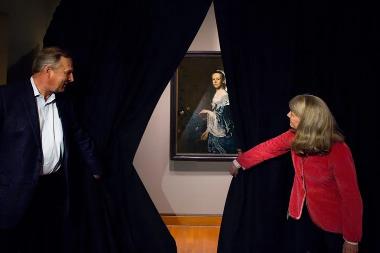 """Timothy Rub, Director and CEO of the Philadelphia Museum of Art, left, and Kathleen Foster, Curator of American Art, right, unveil the painting """"Mrs. James Warren (Mercy Otis)"""" by John Singleton Copley, the Philadelphia Museum of Art """"won"""" the painting from the Boston Museum of Fine Art in a Super Bowl bet, in Philadelphia, Friday, March 9, 2018."""