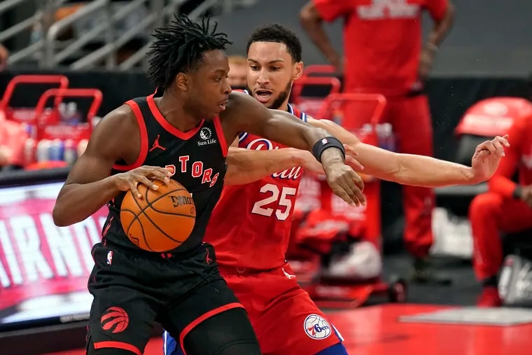 Toronto Raptors forward OG Anunoby (3) works against the 76ers' Ben Simmons (25) during the first half of their game on Sunday, Feb. 21, 2021, in Tampa, Fla.