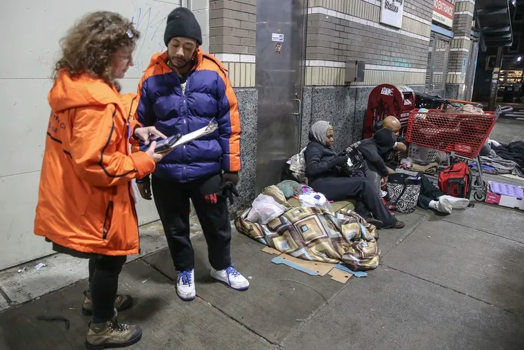 Silvana Mazella, associate executive director of prevention point, counts Shawn Edling at the Allegheny Station in Kensington. Office of homeless servicesÕ biannual homeless count. Last summer, on the last count, the office learned that half the cityÕs homeless people were living on the street in Kensington, Thursday, January 24, 2019.  STEVEN M. FALK  /  Staff Photographer