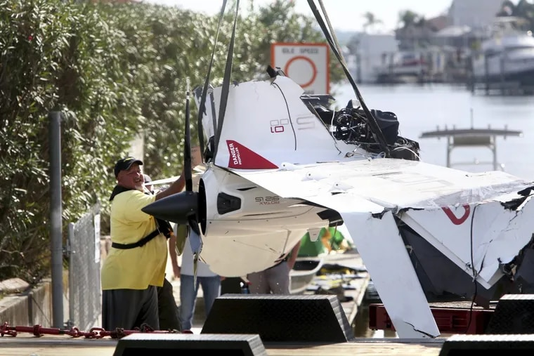 The remains of an ICON A5 ultralight airplane are moved from a boat ramp in the Gulf Harbors neighborhood of New Port Richey, Fla., on Wednesday, Nov. 8, 2017. The private plane, which belonged to Roy Halladay had just been removed from the shallow waters off Ben Pilot Point in New Port Richey where it crashed Tuesday, killing the 40-year-old former Toronto Blue Jays and Philadelphia Phillies pitcher. (Douglas R. Clifford/Tampa Bay Times via AP)