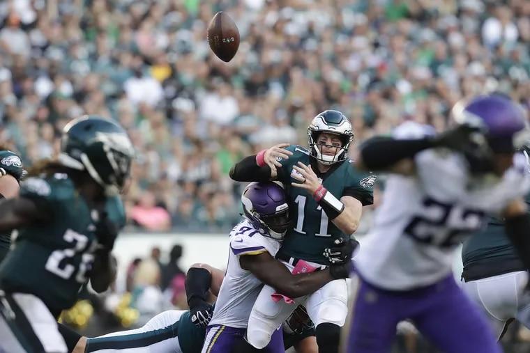 Eagles quarterback Carson Wentz loses the football in the Vikings game. against Minnesota Vikings