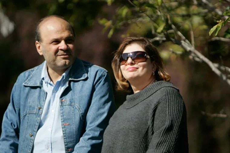 """Hazim Ibrahem and his wife, Shatha Ali. He encouraged her to seek help for depression, and """"now I feel better."""" (David Swanson / Staff Photographer)"""