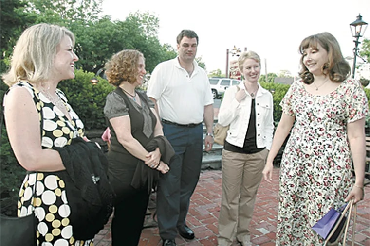 """Members of """"No Kidding"""" group - (from left) Kristi Shelton, Pam Burns, Daryl and Ellen Fenstad and Kathy Lang - chat outside the Cock & Bull Restaurant in Peddler's Village before going in for dinner and a show last month."""