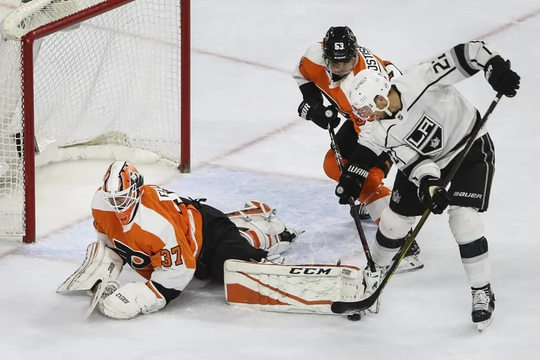 Philadelphia Flyers goalie Brian Elliott stops a shot from the Los Angeles Kings' Trevor Lewis with help from Shayne Gostisbehere during Monday's game at the Wells Fargo Center.