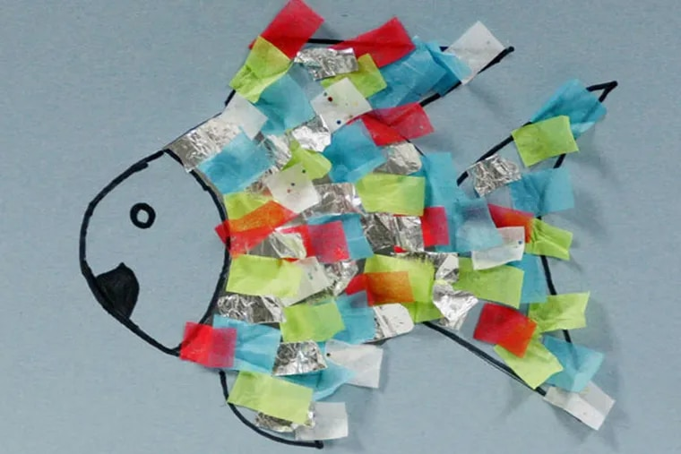 """A brightly-colored fish craft made alongside reading """"The Rainbow Fish"""" can help teach kids about friendship. (Paul Tople/Akron Beacon Journal/MCT) Crafty Kids column (CRAF19F)."""