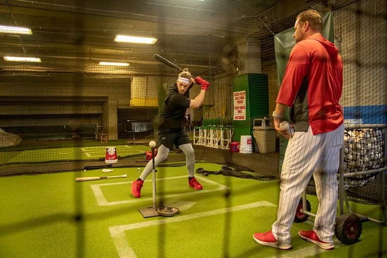 Bryce Harper hits in the batting cage on his first day of spring training in Clearwater.