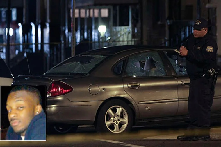 An investigator looks over the car driven by a pizza deliveryman Philippe Holland (inset), who was mistakenly shot and wounded by Philadelphia officers. (Joseph Kazcmarek)