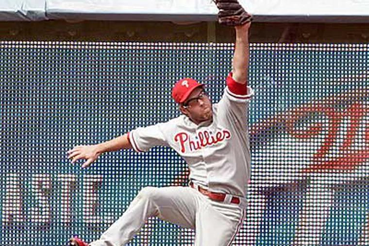 Jayson Werth can't catch Rafael Furcal's game-tying home run in the ninth inning. (AP Photo/Lori Shepler)