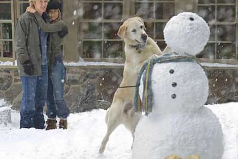 """Owen Wilson and Jennifer Aniston star as John and Jen Grogan, who adopt an overly rambunctious dog in """"Marley & Me."""" Grogan was a former Inquirer columnist."""