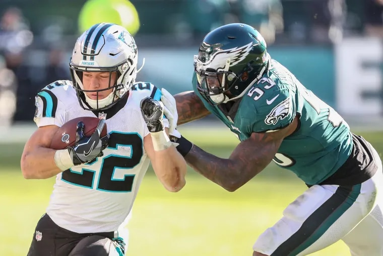 Panthers' running back Christian McCaffrey with a big gain on the Eagles and their former linebacker Nigel Bradham during the teams' last meeting in 2018.