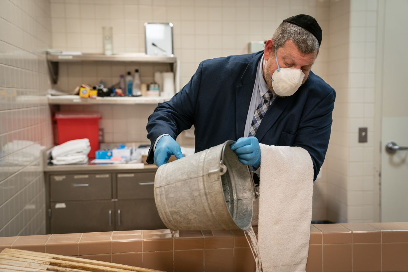 'We ask forgiveness from the dead': Why Jewish volunteers are washing bodies in a pandemic