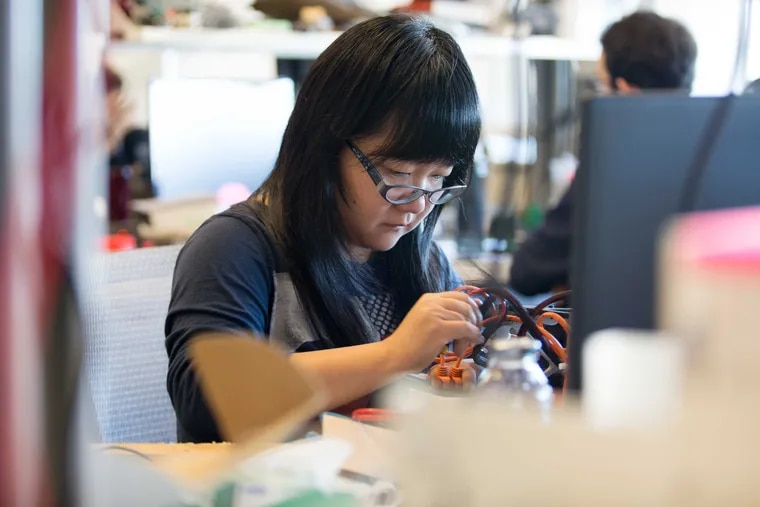 File photo: Feifei Qian works on a project as part of her postdoctoral research in the robotics lab in Pennovation October 7, 2016. The Pennovation Center is home to research labs, business and entrepreneurial offices, and educational facilities.