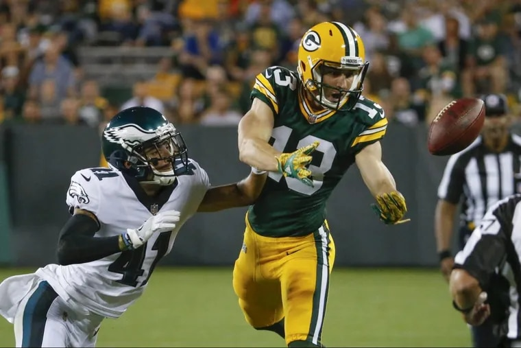 Mitchell White (left), breaking up pass Thursday at Green Bay, was released by the Eagles.