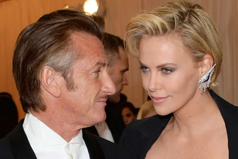 """Sean Penn, left, and Charlize Theron attend The Metropolitan Museum of Art's Costume Institute benefit gala celebrating """"Charles James: Beyond Fashion"""" on Monday, May 5, 2014, in New York."""