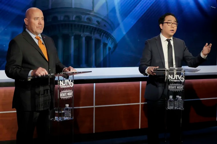 Andy Kim, right, the Democratic candidate in the U.S. Congressional District 3 race, speaks during a debate with Republican candidate Tom MacArthur on Wednesday in Newark.
