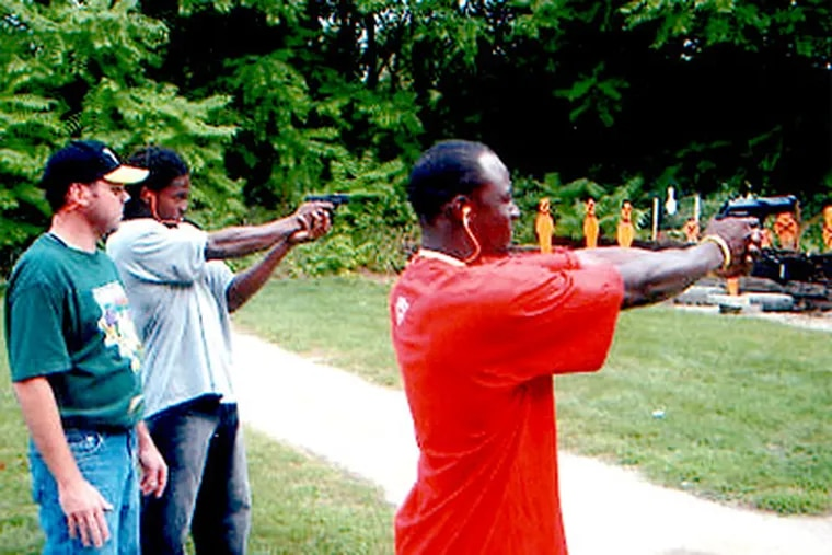 Pittsburgh Steelers players fire pistols during a gun-shooting event in 2006 with state troopers at the Pennsylvania State Police barracks in Greensburg.