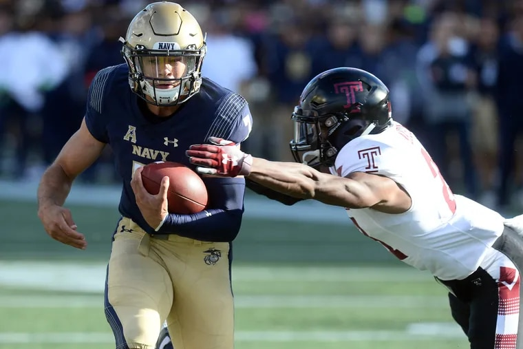 Navy quarterback Garret Lewis, left, gains yardage on a keeper in the second quarter against Temple on Saturday.