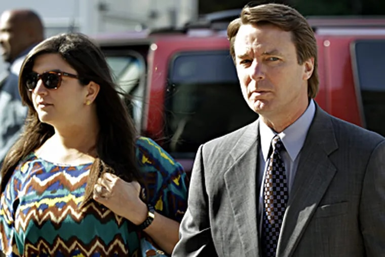 Former Sen. John Edwards arriving at court in Greensboro, N.C., on Monday with his daughter Cate Edwards. CHUCK BURTON / Associated Press