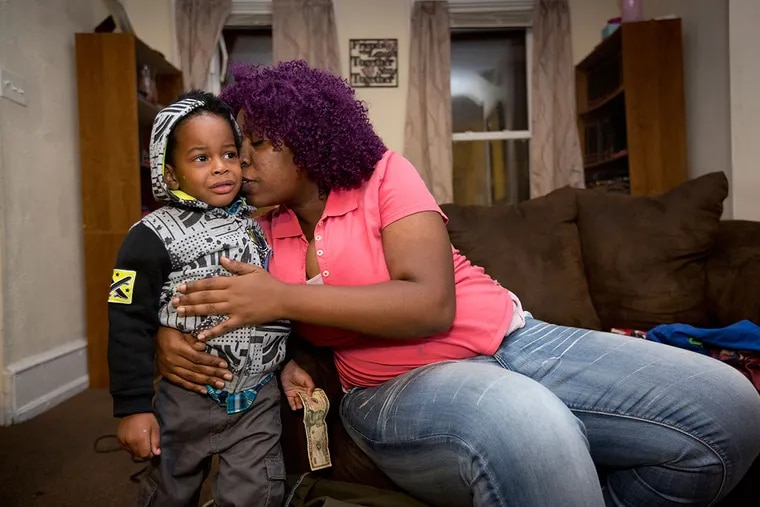 Sophia Pope comforts her son Vaughn before bringing him over to her mother's house. Pope and her husband  Gregory Jackson sent their children to stay at her mother's home after they realized their former rental house was filled with toxic lead.