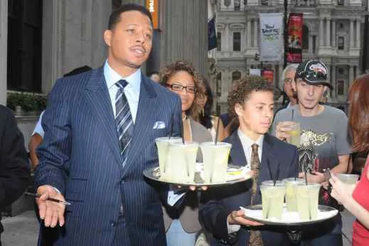 """Actor Terrence Howard and son Hunter sell lemonade outside the Ritz-Carltonin Center City for a charity- Alex's, not Electrolux's. (See """"Feeling the squeeze."""")"""