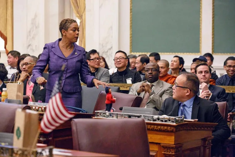 City Councilwoman Cindy Bass (left) stands during Council's Dec. 14, 2017, session. Councilman David Oh is seen sitting (right). Adam Xu, chairman of the Asian American Licensed Beverage Association is seated in the gallery (center, wearing black top). Photo taken before the hearing and vote on Bass' controversial bill that could eventually order the removal of bullet-resistant windows inside businesses like beer delis.