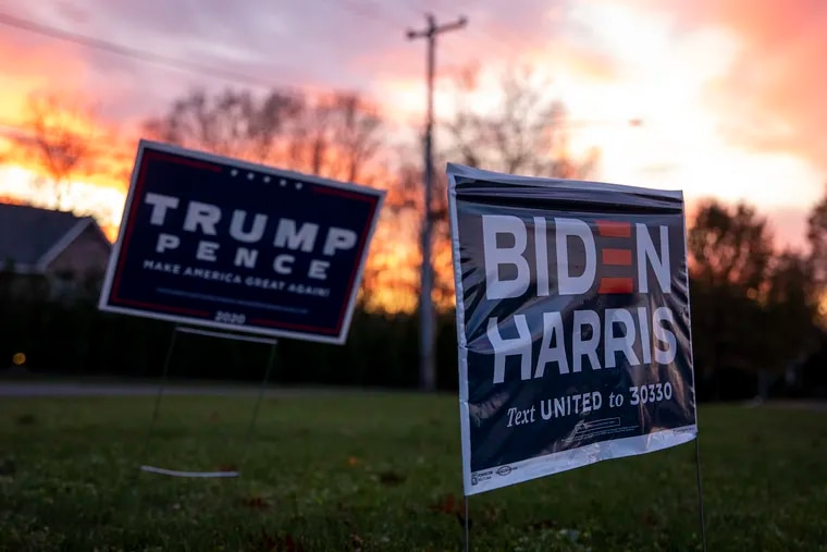 Trump-Pence and Biden-Harris campaign signs on Election Day in Doylestown, Pa. Joe Biden improved on Hillary Clinton's narrow victory in Bucks County. But the Republican congressman prevailed in his race.