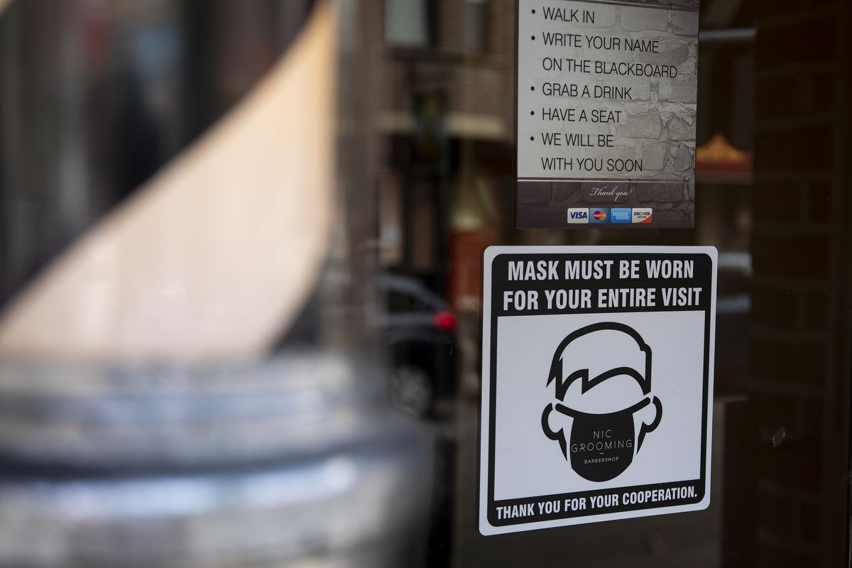 City Council is handing out masks and social-distancing signs to help business owners open