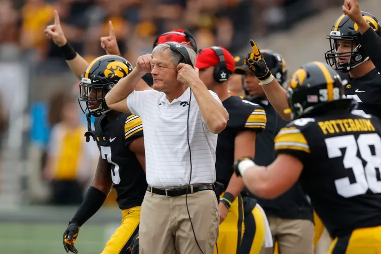 Iowa head coach Kirk Ferentz directs his team against Penn State on Saturday.