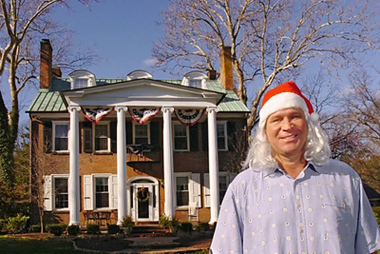 Blaine Applegate, in a Santa hat/wig, standing outside his house in Yardley on a warm December day. He's ready for Christmas. ( Clem Murray / Staff Photographer )