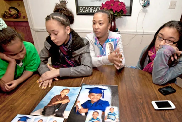 Members of the late Dominick Andujar's family talk about the loss of the little boy at the home of Dominick's uncle, Peter Burgos, on Nov. 20, 2012.  Here, from left to right, Amy Andujar, 9; Amber Andujar, 12; Debbie Burgos; and Tiarra Andujar, 14.  Debbie is the mother of the three girls, as well as Dominick.  APRIL SAUL / Staff Photographer