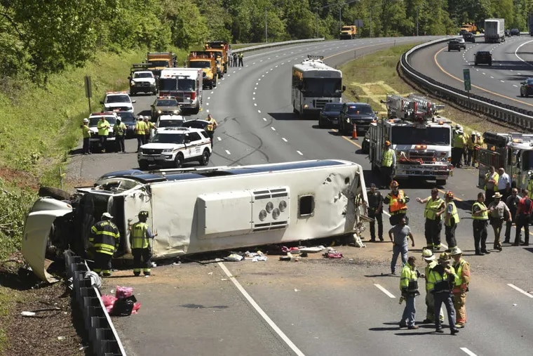 Crews respond to the scene of a serious bus crash on Interstate 95 in Harford County, Md., on Monday. The charter bus was carrying students and chaperones from the C.W. Henry School in West Mount Airy.