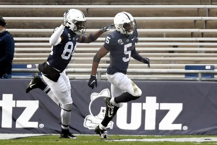 Penn State wide receiver Jahan Dotson (5) celebrates after returning a punt for a touchdown during the  third quarter of NCAA college football game against Michigan State in State College, Pa., on Saturday.