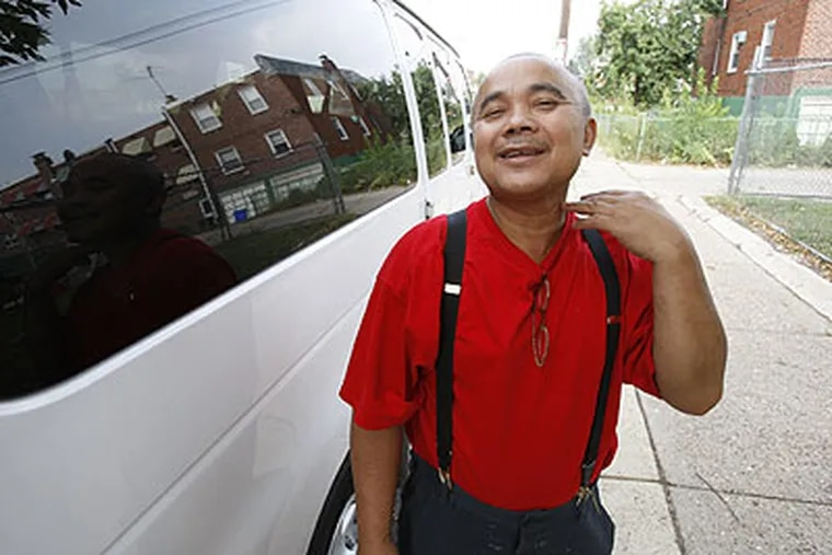 Hak Ouk, 58, makes a throat-cutting gesture as he describes his fate if he returns to the village he left in the 1970s. As a Cambodian soldier, Hak fought alongside U.S. troops in Vietnam. But after firing a gun during a 2000 fight at a Philadelphia Parking Authority lot, he served five months of house arrest.
