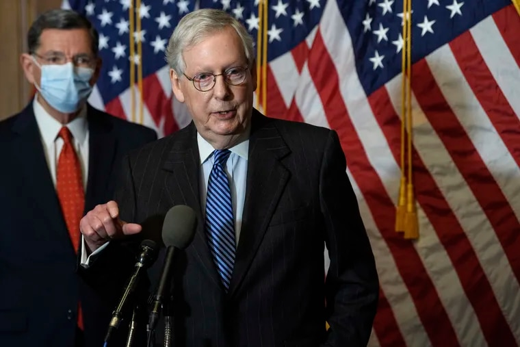 """Senate Majority Leader Mitch McConnell (middle) blocked Democrats' push to immediately bring President Donald Trump's demand for bigger $2,000 COVID-19 relief checks up for a vote, saying the chamber would """"begin a process"""" to address the issue."""