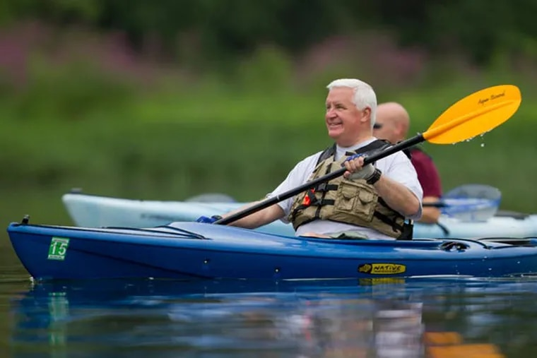 Gov. Corbett kayaks along the Juniata River, north of Harrisburg on Thursday Aug. 8. Thursday was the second day of Corbett's annual kayak voyage in Pennsylvania. (LUKE RAFFERTY/Staff Photographer)