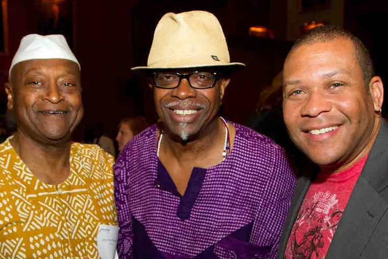Mr. Gibbs (center) stands with fellow musicians Jerome Williams (left) and Leon Jordan in 2011. He was known for his positive attitude and professional manner.