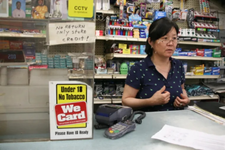 """Shopkeeper Sang Lee, in the grocery store she has run for 15 years. She is resistant. """"I don't want to leave,"""" she said."""