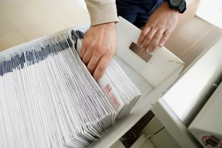 Mail-in ballots are sorted and counted by workers on Election Day in Northampton County. Pennsylvania lawmakers instituted no-excuse mail voting for the first time in 2019.