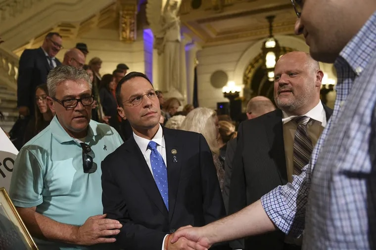Pennsylvania Attorney General Josh Shapiro greets survivors of clergy sex abuse in the State Capitol Monday.