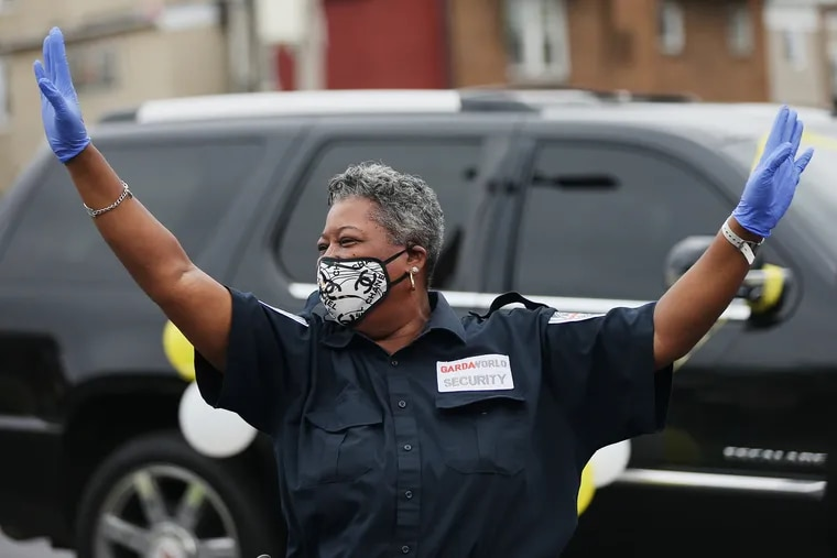 Security guard Tammy Miller (left) dances during a surprise drive-by ceremony recognizing her at the DaVita Cobbs Creek Dialysis center where she works in Southwest Philadelphia on Friday, May 29, 2020. Miller is known by patients and family members for her dancing, which helps them feel better.