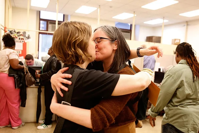 The morning after a judge struck down Pennsylvania's ban on same-sex marriage, couples began the process of getting a marriage license from the Register of Wills at Philadelphia's City Hall. Here, Emily Gavin and Eliza Callard kiss after getting their marriage license this morning.