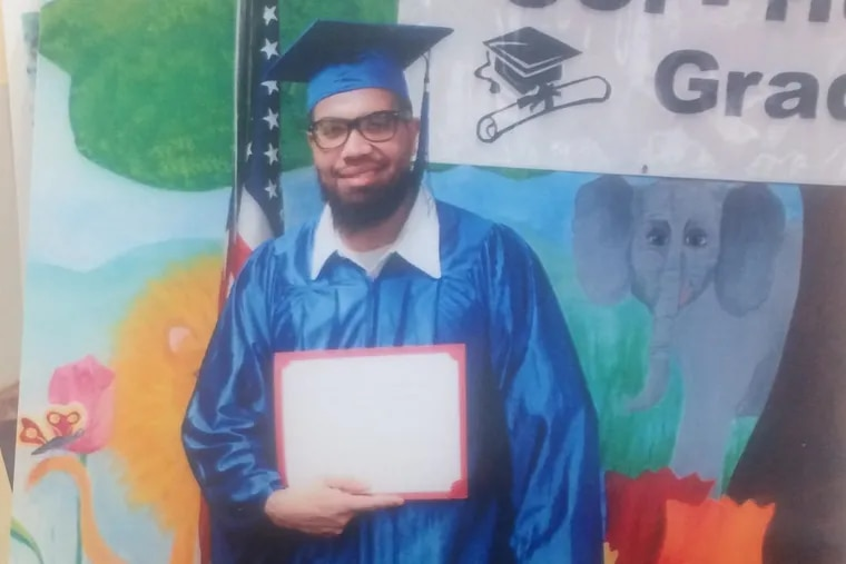 Terrance Lewis graduates from a paralegal certificate program in prison.