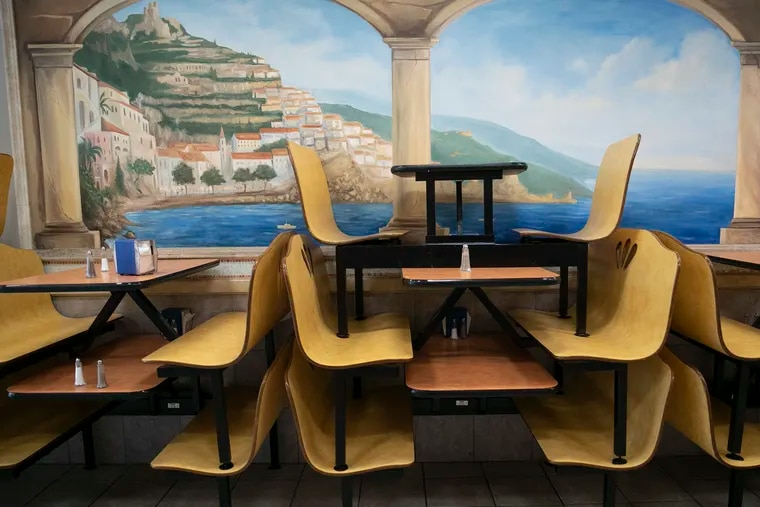 Stacked tables and benches sit along the wall at Lucatelli's in Center City Philadelphia on April 29, 2020.