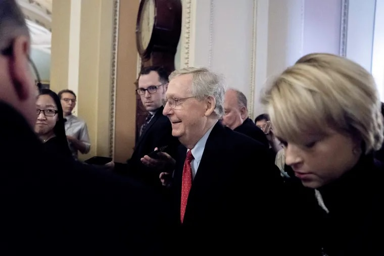 Majority Leader Mitch McConnell hours before the Senate passed sweeping tax reform with no Democratic votes early Saturday morning. (AP Photo/Andrew Harnik)