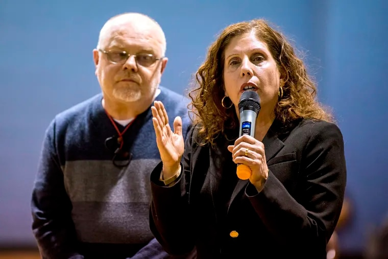 Ronda Goldfein (right), executive director of the AIDS Law Project of Pennsylvania and vice president of Safehouse, speaks with Jose Benitez (left), executive director of Prevention Point and Safehouse's president at a 2019 meeting of the Harrowgate Civic Association at the Heitzman Recreation Center.