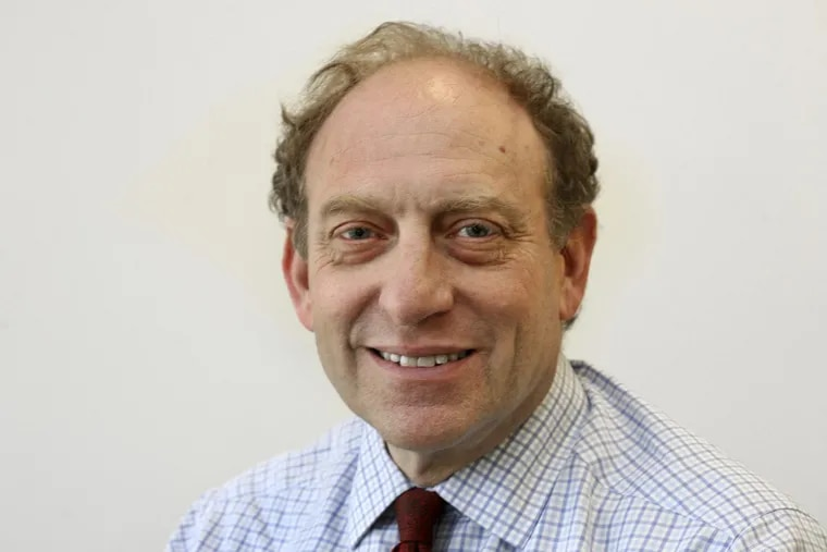 In this March 18, 2015 file photo, former Associated Press Vice President and Senior Managing Editor Mike Oreskes poses for a photo at AP headquarters, in New York.